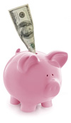 A pink pig piggy bank with paper money coming out of the coin slot on the back of the pig.